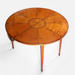 A George III satinwood and marquetry tea table
