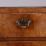 A George II walnut chest of drawers