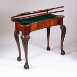 A George III mahogany games table