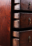 An early 18th century oak chest on stand