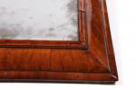 A William & Mary cushion-framed mirror