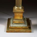 A Victorian brass column table lamp