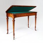 A Victorian walnut card table
