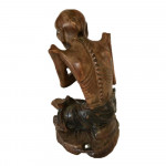 A well carved Chinese root carving of a fasting Buddha with ivory details. Circa 1800