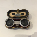 A pair of mother of pearl opera glasses circa 1900 with original leather case