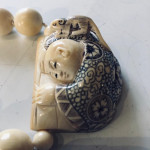 Chinese carved ivory bead necklace with fabulously carved pendant, circa 1930