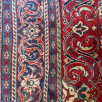 Iranian Sarouk carpet in red and blue wool with medallion design