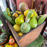A collection of mid 20th century French plaster painted display vegetables.