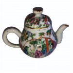 A 19th century miniature porcelain tea pot, circa 1830.
