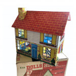 A 1960's Chad Valley M68 printed metal dolls house - printed with 'gay colours'