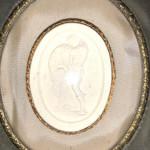 19th century plaster relief plaque in Edwardian velvet frame.