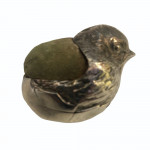 An Edwardian novelty hatching chick silver pin cushion by Samson & Morden