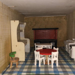 1940's scratch-built dolls' house with four rooms and home-made furniture.