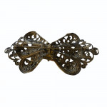 1910 pressed brass and citrine paste bow brooch