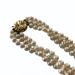 Triple strand of cultured pearls with gold clasp