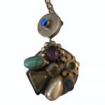 Vintage silver pendant set with semi-precious stones