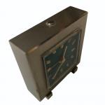 A fine quality Swiss Turler manual wind steel bedside clock, circa 1955