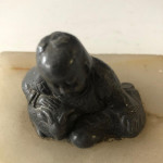 1920s alabaster paperweight with a Japanese figure in bronze.