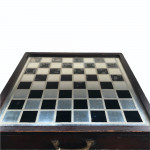 A rare 19th century mercury glass and Verre Églomisé chess board with compartment for chess pieces.