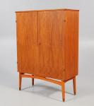 A pair of two-door teak cabinets by Kirke Nielsen