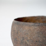 An ancient small hand pressed stoneware vessel