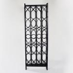 An unusual four-fold ebonised canework screen