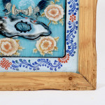 A reverse painted glass framed panel in the Chinese taste