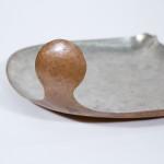 A silvered copper dish