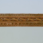 A pair of tall carved and gilded Louis XVI style pier mirrors