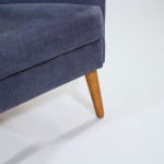 A high back upholstered armchair