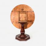 A Biedermeier circular mahogany veneered tilt-top breakfast table