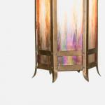 A small Arts & Crafts brass lantern with iridescent glass panels