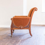 An exceptional late George IV carved mahogany 'easy' chair designed by Thomas King