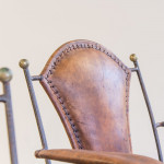 A set of six of unusual iron and leather armchairs