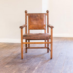 An unusual large carved oak and leather elbow chair attributed to Georg Hulbe (1851- 1917)