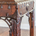 An unusual carved mahogany serving table in the Chinese Chippendale taste