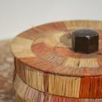 A circular straw work box by Carl Scholz