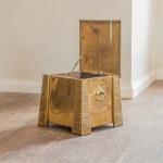 A large and unusual gilt brass coal box