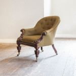 A carved rosewood upholstered library chair by Shoolbred