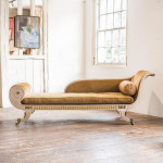 A Regency buff painted and parcel gilt chaise longue