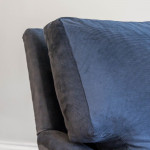 A large and deep upholstered easy chair