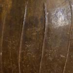 A large glazed stoneware vase with four lug handles