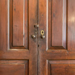 A large George III stained pine housekeeper's cupboard