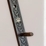 A carved and ebonised Moorish easel