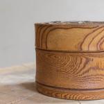 A turned elm cylindrical box