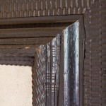 A fine rectangular ripple frame ebonised mirror
