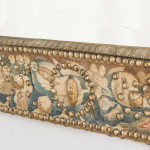A Louis XIV style rectangular mirror with a tapestry covered frame