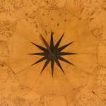 A circular Karelian birch veneered tilt-top occasional table