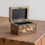 A small rectangular lacquer box decorated with birds and flowers