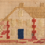 A miniature cross-stitch picture of a cottage